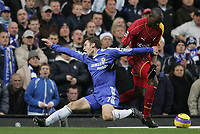 Photo: Lee Earle.<br /> Chelsea v Reading. The Barclays Premiership. 26/12/2006. Chelsea's Andriy Shevchenko (L) clashes with Ibrahima Sonko.