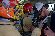 Smokejumpers check harnessing before doing jump tower training at the McCall Smokejumper base in McCall, ID.