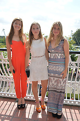 Left to right, ESTHER MACPHERSON, LADY ELOISE GORDON-LENNOX and MARGOT CASE at the 2014 Glorious Goodwood Racing Festival at Goodwood racecourse, West Sussex on 31st July 2014.