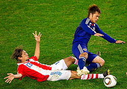 Enrique Vera of Paraguay vs Yuichi Komano of Japan during the 2010 FIFA World Cup South Africa Round of Sixteen football match between Paraguay and Japan on June 29, 2010 at Loftus Versfeld Stadium in Tshwane/Pretoria. (Photo by Vid Ponikvar / Sportida)