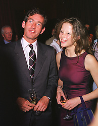 MR TIM JEFFERIES and MISS CATHERINE BOOTH at a party in London on 26th May 1999.MSN 122