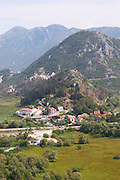 A small village with a big hotel and a dramatic high mountain near Golubovic and Dopilo Montenegro, Balkan, Europe.