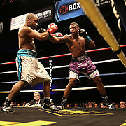 Middleweight fighters Christopher Pearson (purple trunks) fights against  Lanardo Tyner during Showtime Televisions ShoBox:The Next Generation boxing match at the Event Center at Turning Stone Resort Casino on Friday, February 28, 2014 in Verona, New York.  (AP Photo/Alex Menendez)