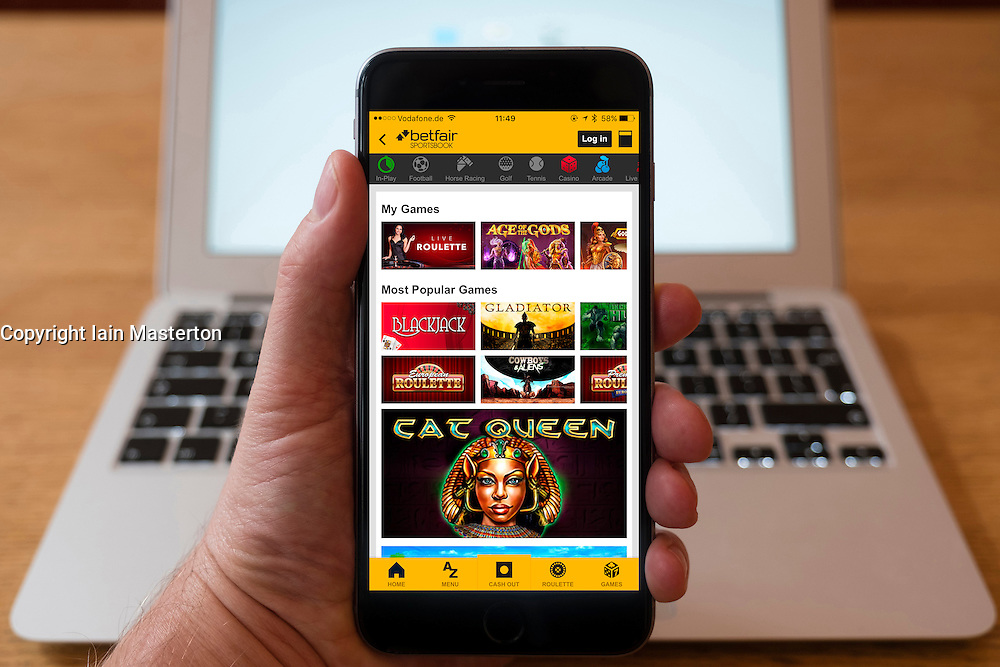 Using iPhone smartphone to display online games within Betfair app