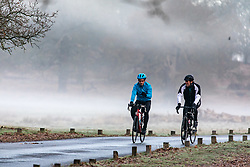 © Licensed to London News Pictures. 23/01/2021. London, UK. Cyclists enjoy a frosty and misty start with lows of -2 in Richmond Park South West London this morning. A chilly weekend ahead is forecast for the South East with the Met Office issuing a yellow weather warning for ice and snow for today and tomorrow. Photo credit: Alex Lentati/LNP