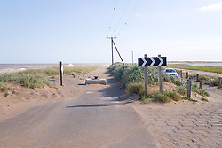 Spurn Head; East Yorkshire; showing the old road which has been closed due to erosion by the sea; the new road being over on the right, The North Sea is to the left and the Humber estuary is to the right of the picture,
