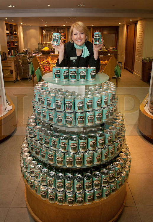 © licensed to London News Pictures. London, UK 23/04/2012. A Fortnum & Mason staff posing on top of a Heinz can pile as Heinz launching a limited edition set of cans to honour the Queens Diamond Jubilee at Fortnum & Mason, this morning (23/04/12). Photo credit: Tolga Akmen/LNP