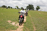 Two Afrikids community support workers travel across the inaccessible countryside, on motorbikes, for home visits. Regular home visits are vital to ensure the psychological, physical, security and educational well being of the children.
