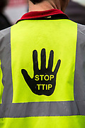 "A Stop TTIP sign, Anti-fracking protesters gathered outside parliament while MP's debate the future of shale. <br /> The protest comes as a group of MPs also warn that fracking must be stopped in the UK because it is ""incompatible"" with climate change targets and could increase the risk of environmental damage to public health. Westminster, London, United Kingdom."