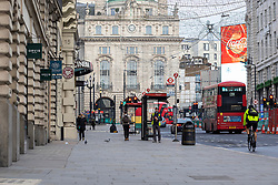 © Licensed to London News Pictures. 09/11/2020. London, UK. Quiet streets during rush hour around Piccadilly Circus in central London. A second national lockdown is now in place to slow the spread of Coronavirus and is expected to last until 2 December 2020. Photo credit: Rob Pinney/LNP