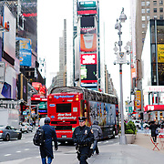 Cop walking in Times Square.