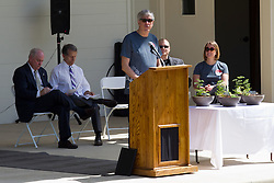 10 May 2014:  Normal Mayor Chris Koos at podium  25th anniversary celebration of the Constitution Trail ceremony at Connie Link Amphitheater in Normal Illinois