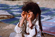 Girl making hand binoculars. Children are quick to imitate skills observed from adults. At the Al Murrah encampment in the Dahana Sands, Saudi Arabia.