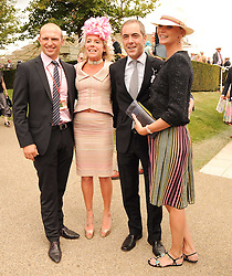 Left to right, MATT DAWSON, COZMO JENKS, JAMES NESBITT and JODIE KIDD at the third day of the 2010 Glorious Goodwood racing festival at Goodwood Racecourse, Chichester, West Sussex on 29th July 2010.