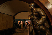 Moscow, Russia, 21/04/2004..The Moscow Metro underground transport system, renowned for its' spectacular Soviet architecture: socialist statues on the platform at Ploschad Revolutsii  [Revolution Square] station.