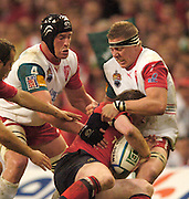 Cardiff, WALES.  Biarritz's, Thomas Lievremont [left] and Imanol Harinordoquy, tackle Paul O'Connell, during the  2006 Heineken Cup Final,  Millennium Stadium,  between Biarritz Olympique and Munster,  20.05.2006. © Peter Spurrier/Intersport-images.com,  / Mobile +44 [0] 7973 819 551 / email images@intersport-images.com.   [Mandatory Credit, Peter Spurier/ Intersport Images].14.05.2006   [Mandatory Credit, Peter Spurier/ Intersport Images].