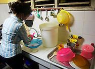 Woman in her kitchen in Gibara,Holguin,Cuba.