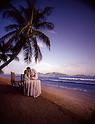 A young couple eats dinner on the coast of the British Virgin Islands