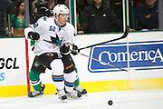DALLAS, TX - OCTOBER 17:  Matt Irwin #52 of the San Jose Sharks controls the puck against the Dallas Stars on October 17, 2013 at the American Airlines Center in Dallas, Texas.  (Photo by Cooper Neill/Getty Images) *** Local Caption *** Matt Irwin