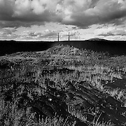 Slag heaps, smoke stacks and blackened rock from decades of emissions from the Coniston Smelter, Coniston, Ontario. From the book Cage Call: Life and Death in the Hard Rock Mining Belt. An in-depth project spanning over 12-years examining communities in one of the richest mining regions in the world located in Northwestern Ontario and Northeastern Quebec in Canada.