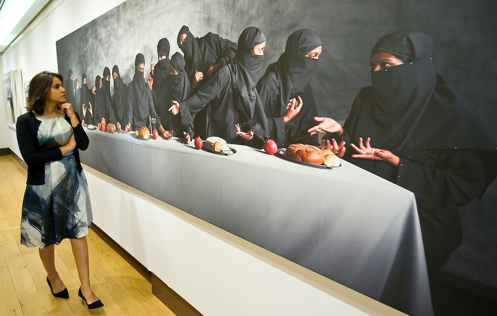 .LONDON, ENGLAND - JUNE 04: Farah Ismail, South Asian Art expert from Christie's looks at 'Last Supper - Gaza' by Vivek Vilasini a re enactment of Leonardo da Vinci composition on June 4, 2009 in London, England...***Standard Licence  Fee's Apply To All Image Use***.Marco Secchi /Xianpix. tel +44 (0) 845 050 6211. e-mail ms@msecchi.com or sales@xianpix.com.www.marcosecchi.com