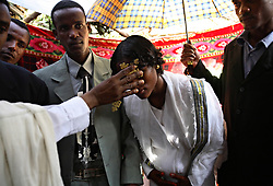 Tsegaya Mekonen, 13, and Talema Meseret, 23, are married at her home in Yeganda Village, Amhara Region, Ethiopia on May 20, 2007. The practice of early marriage remains widespread in Ethiopia, especially in the northern Amhara and Tigray regions, where parents consent to their daughters? consummated marriages when they are still as young as 10 or 12. In Amhara, 50 percent of girls are married by the age of 15, despite the enactment in 2000 of the revised Family Law, which sets the legal age for marriage at 18.