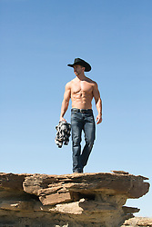 shirtless All American cowboy outdoors