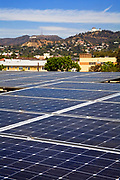 Solar array on rooftop of Asian Pacific Health Care offices with Hollywood Hills and Sign in background, Installation by Martifer Solar USA, Los Angeles, California, USA