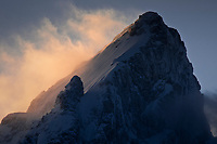 The summit of the Grand Teton glows at sunset in Grand Teton National Park, Wyoming.