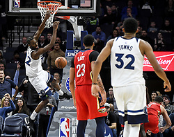 November 14, 2018 - Minneapolis, MN, USA - The Minnesota Timberwolves' Andrew Wiggins (22) follows through with a monster dunk after being fouled on the way to the basket late in the fourth quarter against the New Orleans Pelicans on Wednesday, Nov. 14, 2018, at Target Center in Minneapolis. The Timberwolves won, 107-100. (Credit Image: © Aaron Lavinsky/Minneapolis Star Tribune/TNS via ZUMA Wire)