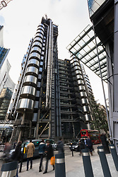 City workers rush past the iconic Lloyds of London building as European markets follow US and Asian markets lower on Tuesday as investors continued to dump shares. London, February 06 2018.