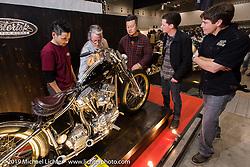 Harley-Davidson's design team talking with Hideki Hoshikawa of Asterisk Motorcycles, the recipient of their Harley-Davidson award, at the Annual Mooneyes Yokohama Hot Rod and Custom Show. (L>R) Hideki Hoshikawa, head of design Ray Drea, Dais Nagao, Ben McGinley and Charlie Wartgow. Japan. Sunday, December 7, 2014. Photograph ©2014 Michael Lichter.