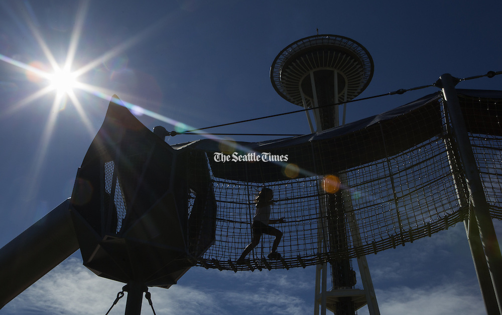 On the last day before Seattle schools start, a child runs on a suspended walkway at the Seattle Center. (Ellen M. Banner / The Seattle Times)