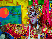 "26 FEBRUARY 2018 - BANGKOK, THAILAND: Performers on stage during a Chinese Opera at the Phek Leng Shrine in the Khlong Toey section of Bangkok. The shrine traditionally hosts a Chinese Opera just after the end of Lunar New Year festivities. Thailand is home to the largest population of overseas Chinese in the world, and Chinese cultural practices, like Chinese opera, called ""ngiew"" in Thailand, are popular. Many of the performers are ethnic Thais who don't speak Chinese. They learn their lines phonetically.    PHOTO BY JACK KURTZ"