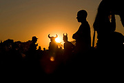 People wearing viking hats still partying in the morning sunrise at Glastonbury festival, 2005.