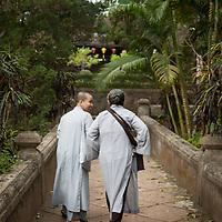 Buddhist nuns walk towards Từ Hiếu Pagoda just outside of Hue, Vietnam.