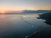 Aerial view of Tahiti coastline at sunset in French Polynesia.