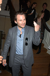 Actor CHRISTIAN SLATER at a party hosted by Dom Perignon and Vanity Fair magazine to celebrate the launch of a unique collection of essays based on the theme of seduction to raise money for the charity English Pen. The paty was held at the Dom Perignon Mallroom,  13 Grosvenor Crescent, London W1 on 8th September 2004.