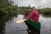 Brule River fishing guide Damian Wilmot  fishes with angler Matson Holbrook in a 1900-era Joe Lucius guide canoe Wilmot meticulously restored over the course of two years.