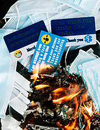 burning facemasks and mask exemption cards