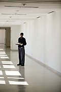 An orderly waits in a corridor with samples on a tray to be taken to a laboratory<br /> <br /> The Medicity, Gurgaon is India's most technologically advanced multi disciplinary hospital. Founded by India's leading cardiac surgeon, Dr Naresh Trehan, it will when completed also contain a medical school and 1600 beds with over 48 operating theatres.