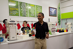 US President Barack Obama smiles after receiving his Shave Ice with cherry, lemon lime, and Melona flavors at Island Snow at Kailua Beach Center in Kailua, Hawaii, USA on December 27, 2010. Photo by Kent Nishimura/Pool/ABACAPRESS.COM  | 258284_006 Kailua Etats-Unis United States