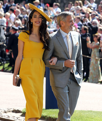 George and Amal Clooney arrive at St George's Chapel at Windsor Castle for the wedding of Meghan Markle and Prince Harry.