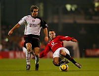 Photo: Javier Garcia/Digitalsport<br /> Fulham v Manchester United, FA Barclays Premiership, Craven Cottage 13/12/04<br /> Ryan Giggs of Man United (R) slides in on Carlos Bocanegra