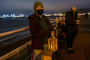 Locals gathered on Dover seafront for a candlelit vigil to mark the tragic death of the Kurdish-Iranian family who lost their lives attempting to seek asylum, on the 30th of October 2020 in Dover, United Kingdom. The loss of an entire family was completely avoidable, Resoul Iran-Nejad, Shiva Mohammed Panahi and their children Anita (age 9), Armin (age 6) and Artin (age 15 months) lost their lives needlessly, campaigners are calling for a Safe Passage Now for Refugees.