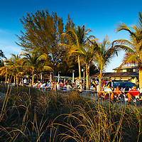 Famous for sunsets over the Gulf of Mexico, visistors and residents gather near the Mucky Duck bar and restaurant to enjoy a perfect sunset.