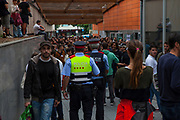 Members of the public stand mingle with Catalan Police Mossos d'Esquadra at the voting centre at Sant Cugat del Valles sports hall on October 1st, during the Catalan independence referendum. <br /> <br /> On October 1st 2017, Catalans voted in a binding referendum to decide whether the region should stay in Spain, or leave and become an independent Republic. The Madrid government of Mariano Rajoy sent thousands of extra police into Catalonia, brutally attacking around 10% of  voting centres and seizing ballot boxes, injuring nearly 1000 people in an effort to stop the vote. Despite the violence, there was turn turnout of well more than 42% with around 90% in favour of independence. Some 770,000 votes from an electorate of 5.5 million were stolen by police forces or unable to be cast because of raids.
