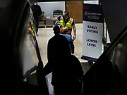 On the first day of early voting in Dayton, Ohio the lines extended from the voting booths on the lowest level, up three floors and into the parking garage.  Voters waiting to cast their ballots were directed by election officials on where to stand at six foot intervals.