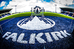 """A close up of the """"Falkirk"""" sign at the tunnell, at The Falkirk Stadium, with the new pitch, for the Scottish Championship game v Hamilton. The woven GreenFields MX synthetic turf and the surface has been specifically designed for football with 50mm tufts compared with the longer 65mm which has been used for mixed football and rugby uses.  It is fully FFA two star compliant and conforms to rules laid out by the SPL and SFL.<br /> ©Michael Schofield."""