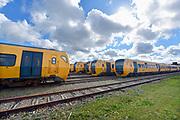 Nederland, Nijmegen, 17-3-2019Het centraal station van de stad met daarachter de woontorens van de SSHN en Talis en kantoorgebouw metterswane . Op het rangeerterrein staan enkele sprinter treinstellen, buffels, die zijn verkocht aan roemenie, sommigen met graffiti . Het station gaat binnenkort gemoderniseerd worden.Foto: Flip Franssen